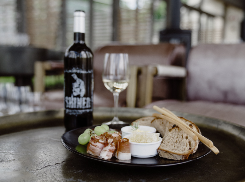 the shiner wine with food platter at paserene tasting lounge one of the top wine tasting near franschhoek in cape town