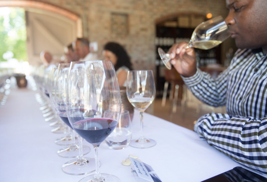 a man sipping wine at paserene tasting lounge one of the top wine tasting near franschhoek in cape town
